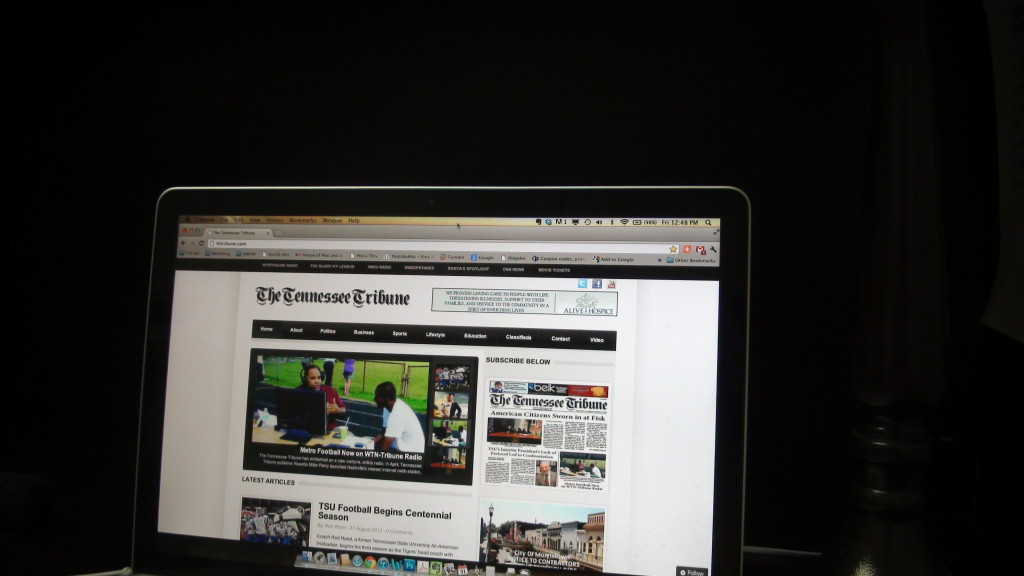 A staff member of The Tennessee Tribune opens his web browser to www.tntribune.com (Photo By: Jason Luntz/Full Sail)